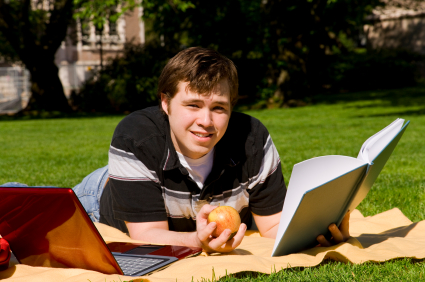 College Student reading book outside